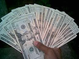 Fanned Money in hand